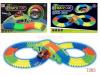 Автотрек Magic Track гибкий с тонелем в кор.флуоресцентный 128 деталей 7202